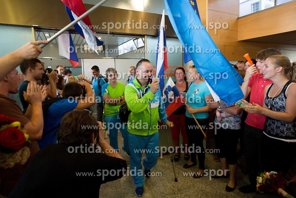 Darko Duric, Polona Sladic and Francek Gorazd Tirsek of Team Slovenia at arrival to Airport Joze Pucnik after the London 2012 Paralympic Games on September 10, 2012, in Brnik, Slovenia. (Photo by Vid Ponikvar / Sportida.com)