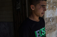 Doread exits his mother and brother's cemetery in Damour, Lebanon on Sunday, June 8, 2014.