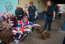 25/04/2015. Royal fans meet with police sniffer dogs, while they check the grounds surrounding the Lindo Wing of St Mary's hospital in Padding, where The Duchess of Cambridge is due to give birth. Photo credit: Ben Cawthra