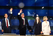 U.S President Bill Clinton with daughter Chelsea and first lady Hillary Rodham Clinton wave to supporters along with Vice President Al Gore as confetti falls after they accepted the nomination for the democrat party at the 1996 Democratic National Convention August 29, 1996 in Chicago, IL.