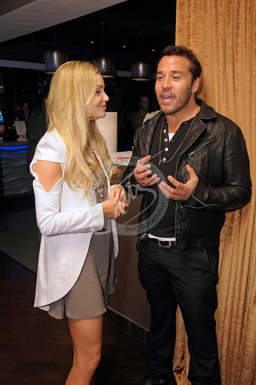 "Actors Jeremy Piven and Izabella Miko chat at a celebrity fundraiser for Miko's ""Eko Miko"" line of environmentally conscious products in Hollywood."
