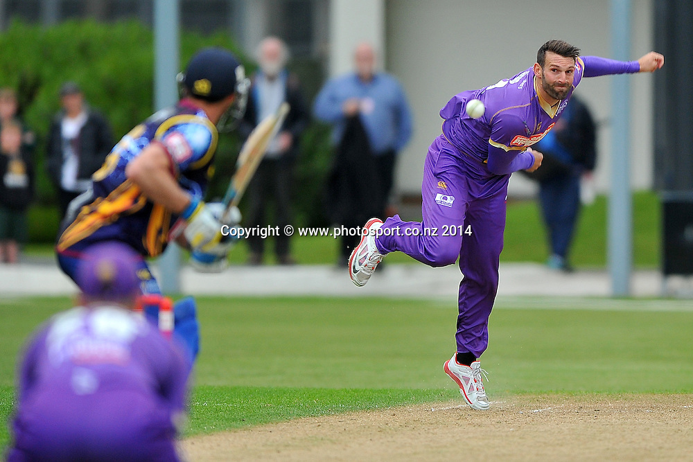 Andrew Ellis of the Canterbury Kings bowls, during the Georgie Pie Twenty20 match between the Otago Volts and the Canterbury Kings, held at the University Oval, Dunedin, New Zealand, 20 November 2014. Credit: Joe Allison / www.photosport.co.nz