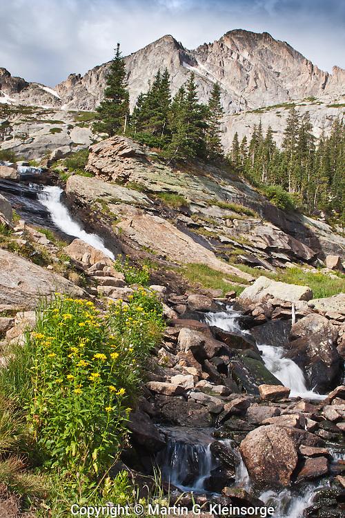 Ribbon Falls below 13,327 ft. Mchenrys Peak in Glacier Gorge.  Rocky Mountain National Park, Colorado.