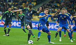 KIEV, UKRAINE - Easter Monday, March 28, 2016: Wales' Ben Davies in action against Ukraine's Denys Garmash during the International Friendly match at the NSK Olimpiyskyi Stadium. (Pic by David Rawcliffe/Propaganda)