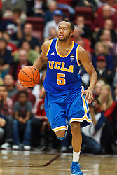 Dec 29, 2011; Stanford CA, USA;  UCLA Bruins guard Jerime Anderson (5) dribbles the ball up court against the Stanford Cardinal during the second half at Maples Pavilion.  Stanford defeated UCLA 60-59. Mandatory Credit: Jason O. Watson-US PRESSWIRE