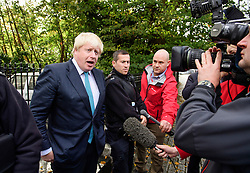 ©  London News Pictures. 16/10/2016. London, UK. British foreign secretary BORIS JOHNSON speaking to media as he leaves his London home on the morning that a pro EU article he wrote was published in a Sunday newspaper. Photo credit: Ben Cawthra/LNP