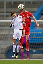 LIVERPOOL, ENGLAND - Tuesday, December 9, 2014: Liverpool's Daniel Cleary in action against FC Basel's Nicolas Hunziker during the UEFA Youth League Group B match at Langtree Park. (Pic by David Rawcliffe/Propaganda)