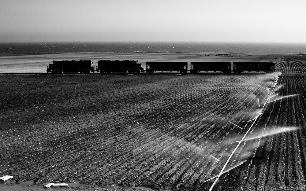 A few miles south of Davenport, the tri-weekly local is bringing home a light load of empty hoppers back to Watsonville Junction. This train will be in view of the Pacific for most of its journey home. These ex-Rio Grande units are a long way from the mountains of home.