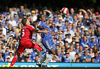 Photo: Lee Earle.<br /> Chelsea v Liverpool. The Barclays Premiership. 17/09/2006. Chelsea's Didier Drogba (R) holds off Daniel Agger.
