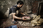 "A young worker ""Zabbeleen"" sieve the material used in a workshop of Mokattam where it is classified and crushed in different types of plastic for recycling.On the outskirts of Cairo in the middle of Manshiet Nasr neighborhood is located Mokattam settlement known as ""Garbage City"" is inhabited by Zabbaleen, a community of about 45,000 Coptic Christians living for decades to recycle waste generated by the Egyptian capital: plastic, aluminum, paper and organic waste transformed into compost. Most part of the Association for the Protection of the Environment (APE), an NGO that works in the area, whose objectives are to protect the environment and improve the livelihoods of garbage scavengers in Cairo. According to the UN, the work is done in Mokattam is one of the ten best examples of world environmental improvement. El Cairo , Egypt, June 2011. ( Photo by  Jordi Camí )."