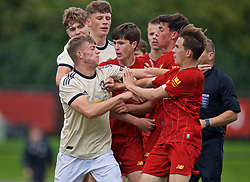 KIRKBY, ENGLAND - Saturday, August 31, 2019: Manchester United's Reece Devine pushes Liverpool's Layton Stewart and Ritaccio Matteo after the Under-18 FA Premier League match between Liverpool FC and Manchester United at the Liverpool Academy. Liverpool won 4-3. (Pic by David Rawcliffe/Propaganda)
