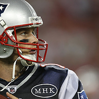 New England quarterback Tom Brady (12) warms up on the sidelines during an NFL football game between the New England Patriots and the Tampa Bay Buccaneers at Raymond James Stadium on Thursday, August 18, 2011 in Tampa, Florida.   (Photo/Alex Menendez)