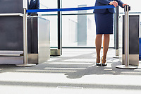 Portrait of young beautiful airport staff opening the gate for boarding in airport