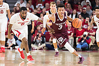 FAYETTEVILLE, AR - FEBRUARY 17:  Admon Gilder #3 of the Texas A&M Aggies drives past Arlando Cook #5 of the Arkansas Razorbacks at Bud Walton Arena on February 17, 2018 in Fayetteville, Arkansas.  The Razorbacks defeated the Aggies 94-75.  (Photo by Wesley Hitt/Getty Images) *** Local Caption *** Admon Gilder; Arlando Cook