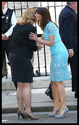 Sarah Brown is greeted by Samantha Cameron as she arrives with Gordon Brown for lunch with The Queen and Duke of Edinburgh, Prime Minister David Cameron  and former Prime Minister's at 10 Downing St.,London,  Tuesday, 24th July 2012.  Photo by: Stephen Lock / i-Images