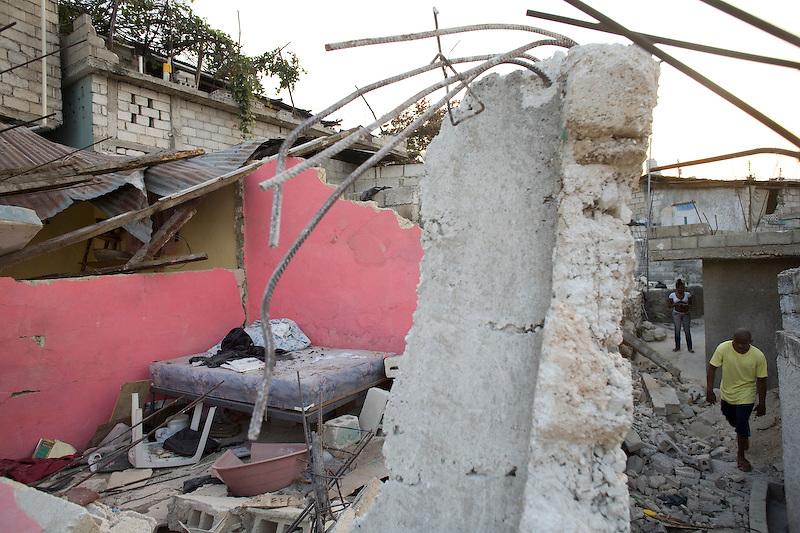 Wilner Datoes walks through the rubble of his neighborhood. Nerette, Haiti. Photo by Ben Depp. 2/8/2010