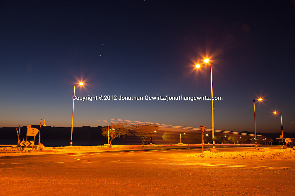 Pre-dawn traffic on Highway 90 on the western Dead Sea coast. WATERMARKS WILL NOT APPEAR ON PRINTS OR LICENSED IMAGES.