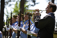 Michael Lenke plays taps on his bugle following a 21-gun salute at the end of the Memorial Day ceremony at Forest Cemetery.