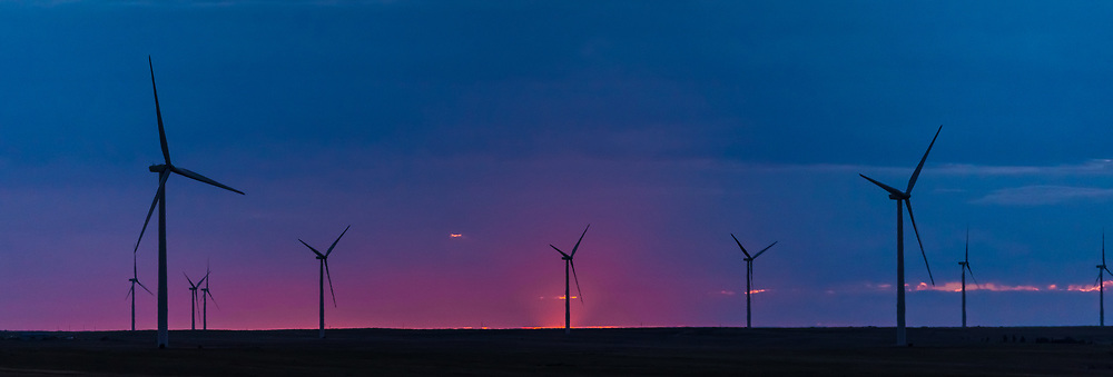 A silhouette of some windmills on the Colorado plains at sunrise.<br /> <br /> Camera <br /> NIKON D610<br /> Lens <br /> 70.0-200.0 mm f/4.0<br /> Focal Length <br /> 200<br /> Shutter Speed <br /> 1/1250<br /> Aperture <br /> 4<br /> ISO <br /> 500