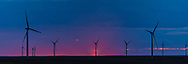 A silhouette of some windmills on the Colorado plains at sunrise.<br />