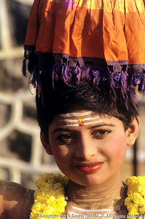 A school boy performing the traditional and famous folk dance of Tamilnadu 'KARAGATTAM' during the Republic day celebrations on the Marina ,Chennai,India.
