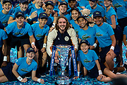 Stefanos Tsitsipas of Greece celebrates with his trophy and the ball kids  during the Nitto ATP finals at the O2 Arena, London, United Kingdom on 17 November 2019.