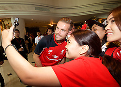 BANGKOK, THAILAND - Monday, July 13, 2015: Liverpool's captain Jordan Henderson poses for a selfie with supporters at the Plaza Athenee team hotel in Bangkok on day one of the club's preseason tour. (Pic by David Rawcliffe/Propaganda)