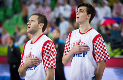 Bojan Bogdanovic #7 of Croatia and Dario Saric #8 of Croatia listening to the national anthem during basketball match between National teams of Lithuania and Croatia in Semifinals at Day 17 of Eurobasket 2013 on September 20, 2013 in Arena Stozice, Ljubljana, Slovenia. (Photo by Vid Ponikvar / Sportida.com)