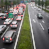 Asia, Tokyo, Japan, Blurred image of traffic jam in spring rain