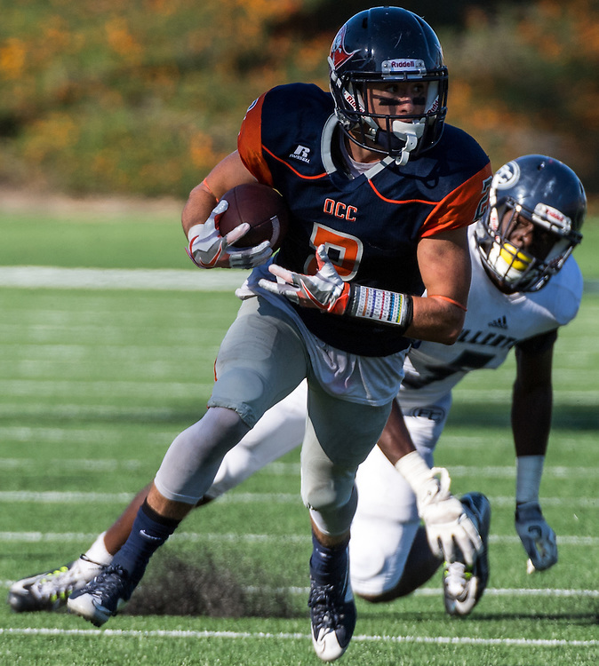 November 5, 2016 - Santa Ana, CA - Orange Coast College Freshman WR Joey Cox (2) slips a tackle by Fullerton College Sophomore DB Javon Burriss (5) in their 35-14 loss