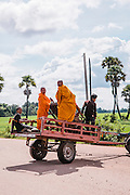 "Monks on tractor trailer on the way to Preah Da, ""Num Banh Chok village"", Siem Reap"