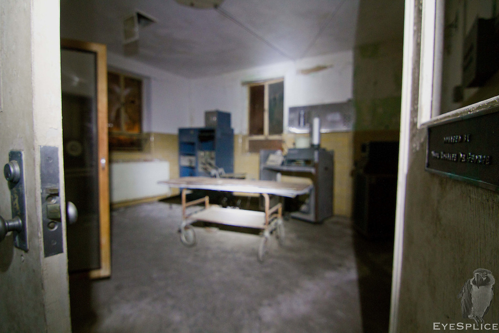 The surgery table and other instruments still remain in the operating room.
