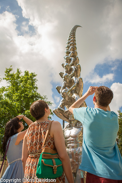 Art students contemplating Do-Ho-Suh's Karma in the sculpture garden at the New Orleans Museum of Art.