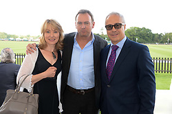 Left to right, BETH GODDARD, PHILIP GLENISTER and JON ZAMMETT at the Audi International Polo at Guards Polo Windsor Great Park, Egham, Surrey on 28th July 2013.