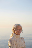 Young woman smiling on beach portrait