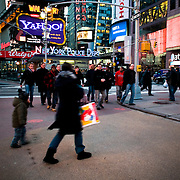 Pedestrians in Times Square, New York, February 18, 2010.