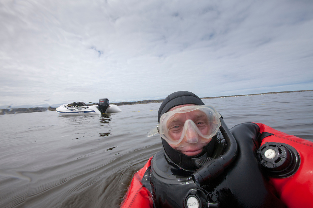 Canada, Manitoba, Self-portrait of photographer Paul Souders snorkeling in drysuit in Hudson Bay