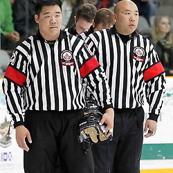 TRENTON, - Apr 21, 2016 -  Ontario Junior Hockey League game action between the Trenton Golden Hawks and the Georgetown Raiders. Game 5 of the Buckland Cup Championship Series, OHA Referee at the Duncan Memorial Gardens, ON. (Photo by Amy Deroche / OJHL Images)