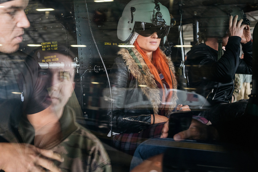 Prince George's County, MD - December  13, 2016:  WWE Superstars Chad Gable, left,  Becky Lynch, center, and Dolph Ziggler, right, check out the inside of a UH-1N Huey helicopter before taking a tour of the restricted air space in Washington D.C. during Tribute to the Troops Day at the Joint Base Andrews in Prince George's County, Maryland.  WWE Superstars will spend time with members of all five branches of the military.  WWE began Tribute to the Troops in 2003 as a way to honor our servicemen and women and their families.   (Greg Kahn for ESPN)