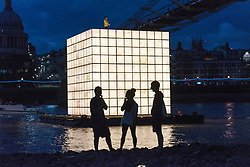 © Licensed to London News Pictures. 31/08/2016.An illuminated, large scale floating installation by IK-JOONG KANG, one of South Korea's most renowned artists. Depicting the memories of displaced Koreans, 'FLOATING DREAMS'  calls for the reunification of North and South Korea. It is part of Totally Thames Festival (1-30 September), and is situated in the centre of the River Thames by the Millennium Bridge in London, and illuminated from within.  London, UK. Photo credit: Ray Tang/LNP
