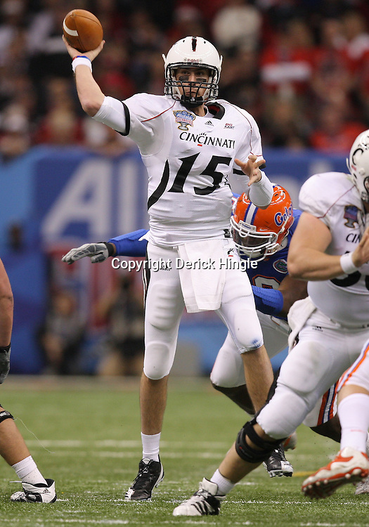 Jan 01, 2010; New Orleans, LA, USA;  Cincinnati Bearcats quarterback Tony Pike (15) throws a pass against the Cincinnati Bearcats during the second half of the 2010 Sugar Bowl at the Louisiana Superdome.  Mandatory Credit: Derick E. Hingle-US PRESSWIRE.