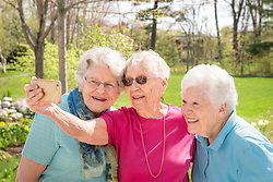 Thornton Oaks residents take selfies and sit on patio in Spring