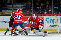 KELOWNA, CANADA - MARCH 13:  Bailey Brkin #31 makes a save as Jaret Anderson-Dolan #11 of the Spokane Chiefs blocks a player of the Kelowna Rockets during second period on March 13, 2019 at Prospera Place in Kelowna, British Columbia, Canada.  (Photo by Marissa Baecker/Shoot the Breeze)