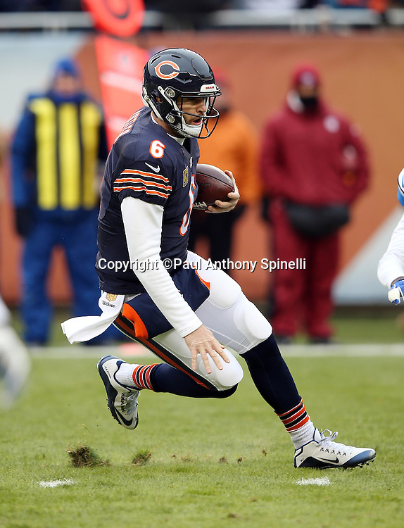 Chicago Bears quarterback Jay Cutler (6) slides safely as he runs for a first quarter first down at the Detroit Lions 12 yard line during the NFL week 17 regular season football game against the Detroit Lions on Sunday, Jan. 3, 2016 in Chicago. The Lions won the game 24-20. (©Paul Anthony Spinelli)
