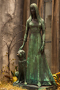 The artistry of bronze and stone statues on outside of crypts has been admired since 1822, Recoleta cemetery , Buenos Aires, Argentina.