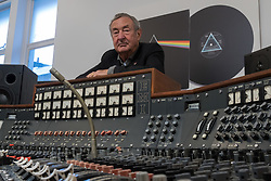 Bonhams, London, March 20th 2017. Pink Floyd drummer Nick Mason poses with the Abbey Road Studios EMI TG12345 MK IV recording console Pink Floyd used to record their landmark album, The Dark Side of the Moon, to be sold by Bonhams at their TCM Presents...Rock and Roll Through the Lens sale in New York on 27 March 2017