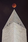 The moon hangs over the Washington Monument in Washington, D.C. during the Super Blood Moon Eclipse on September 27th, 2015.