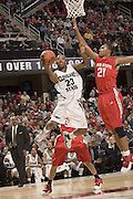 December 18, 2007: Cleveland State University's Joe Davis #23 goes to the basket against Ohio States Evan Turner #21 during the John McClendon Scholarship Classic in Cleveland, Ohio. Ohio State won the match 80-63. Michael Ciu.