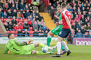 Jordan White (Wrexham AFC) slips the ball past Scott Loach (York City) and Danny Parslow (York City) to score his side's first goal of the game and equalise to make it 1-1 during the Vanarama National League match between York City and Wrexham FC at Bootham Crescent, York, England on 17 April 2017. Photo by Mark P Doherty.
