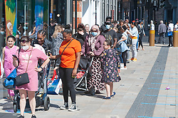 ©Licensed to London News Pictures 15/06/2020<br /> Bromley, UK. Hundreds of people queuing halfway down Bromley high street for Primark in Bromley, South East London. Shops around the UK have reopened their doors today after three months on Coronavirus lockdown. Photo credit: Grant Falvey/LNP